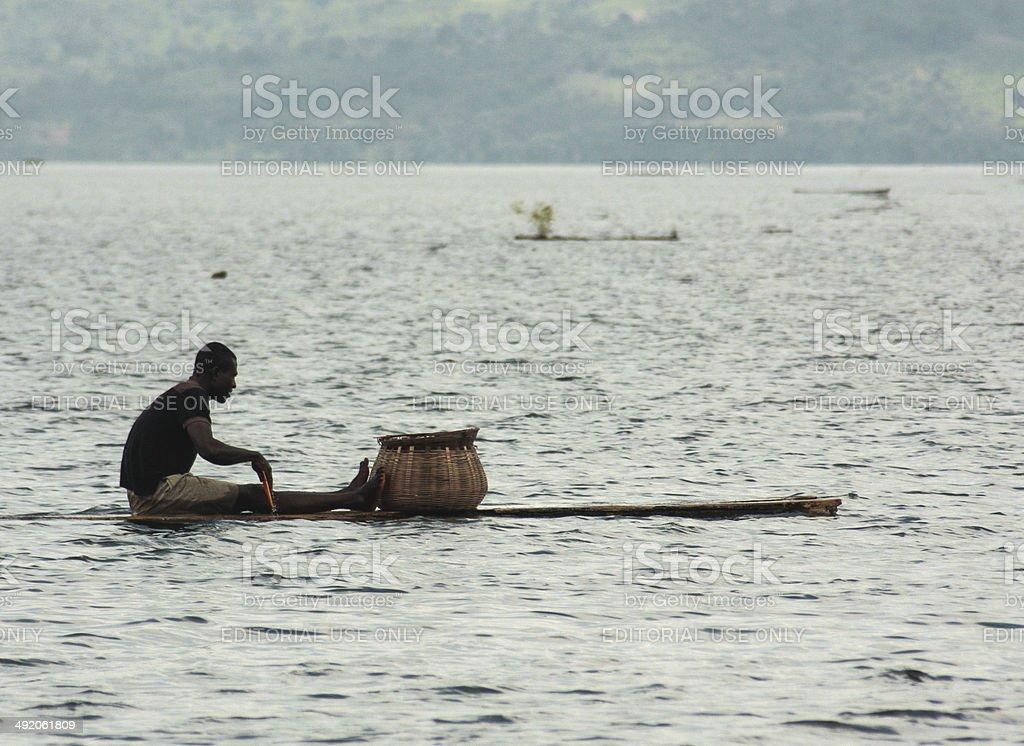 Fisherman at the lake Bosumtwi, Ghana stock photo