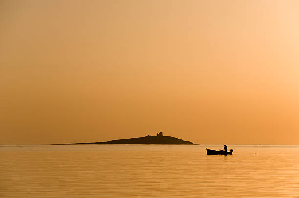 fisherman at the sunset - mahroch stock pictures, royalty-free photos & images