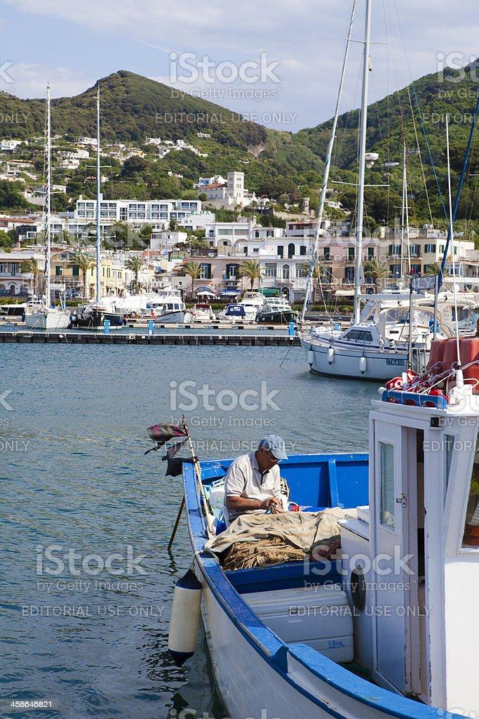Fisherman at Work on Boat, Ischia, Italy stock photo