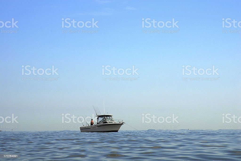 Fisherman Awaits His Catch stock photo