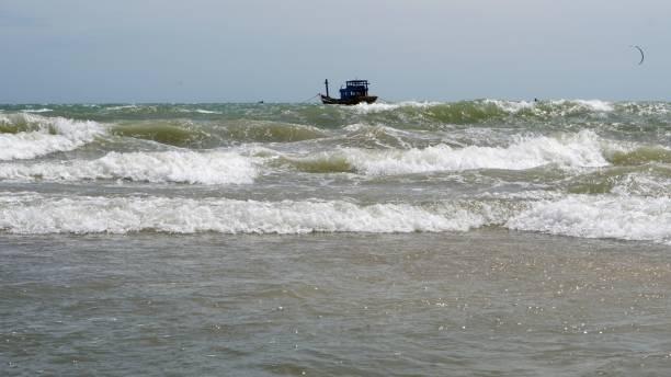 fisherman boat at sea stock photo