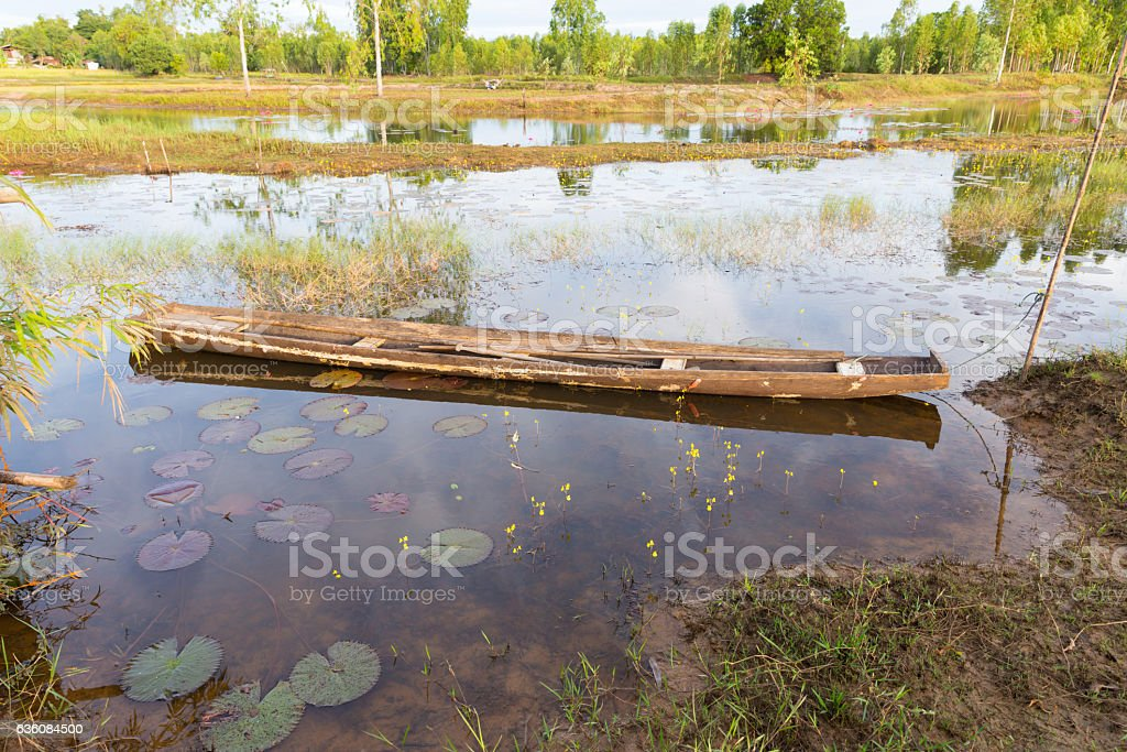 Fisherman boat on a pond stock photo