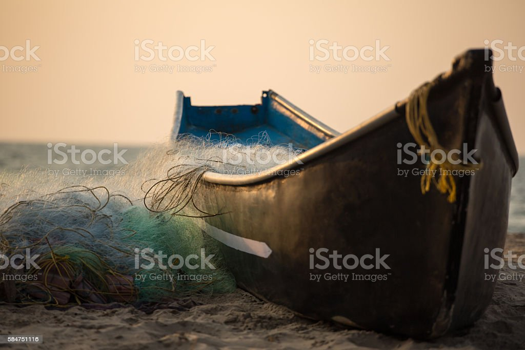 Fisherman boat with fishing nets on the Gokarna beach stock photo