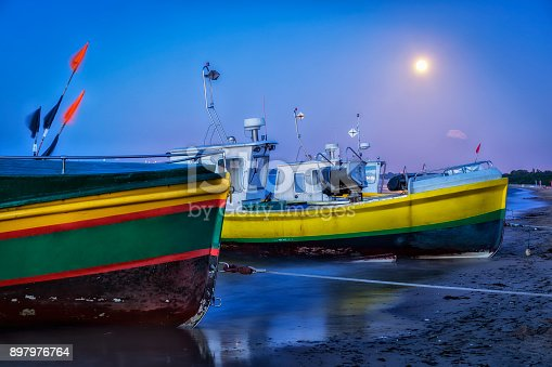 Fisherman boats on the beach in Sopot by night, Poland