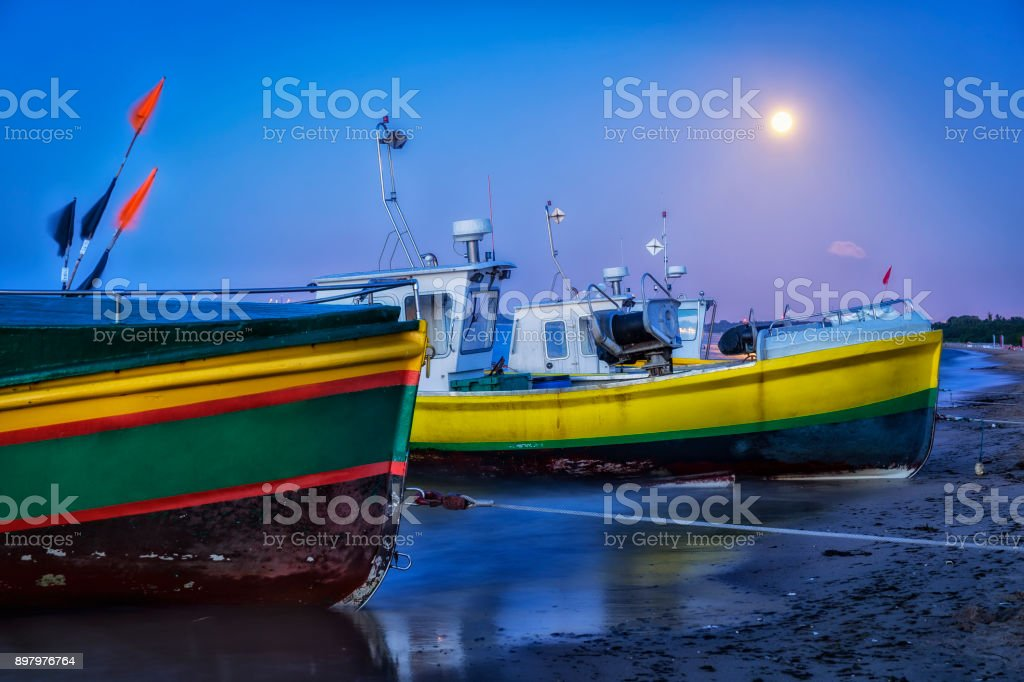 Fisherman boats on the beach in Sopot by night, Poland stock photo
