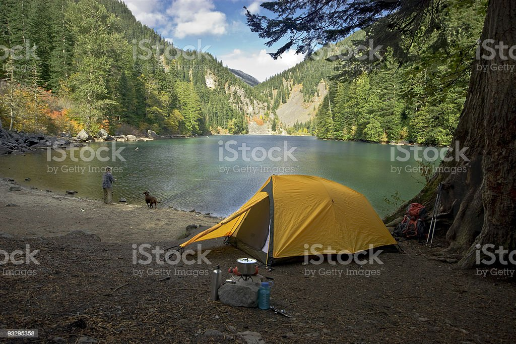 Fisherman camping at a wilderness lake stock photo