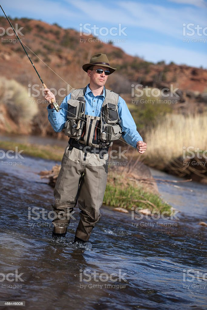 Fisherman casting his flyline stock photo