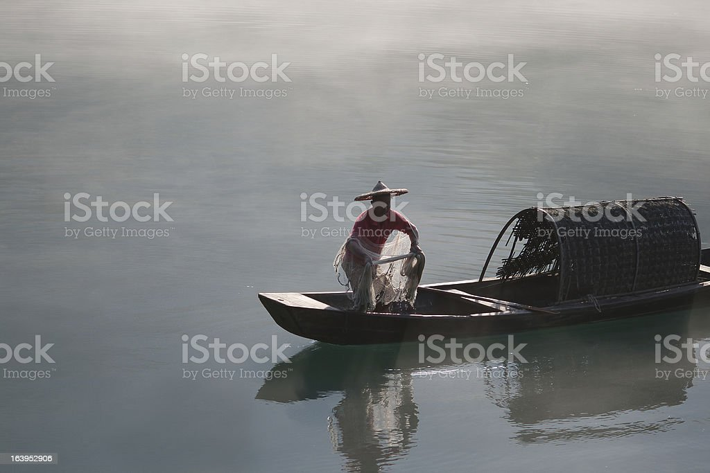 Fisherman casting net on river royalty-free stock photo