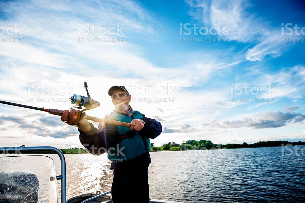 Fisherman Casting Out His Line stock photo