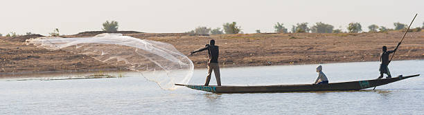 Fisherman casts a net on the Niger River, Mali. stock photo