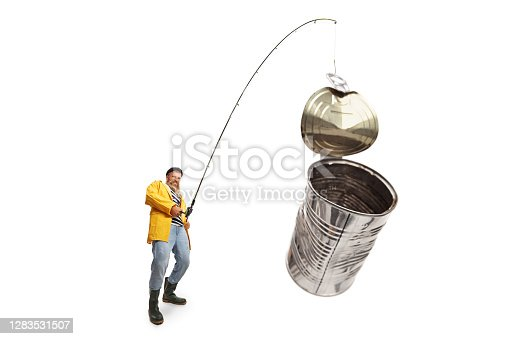 istock Fisherman catching tin can on a fishing rod 1283531507