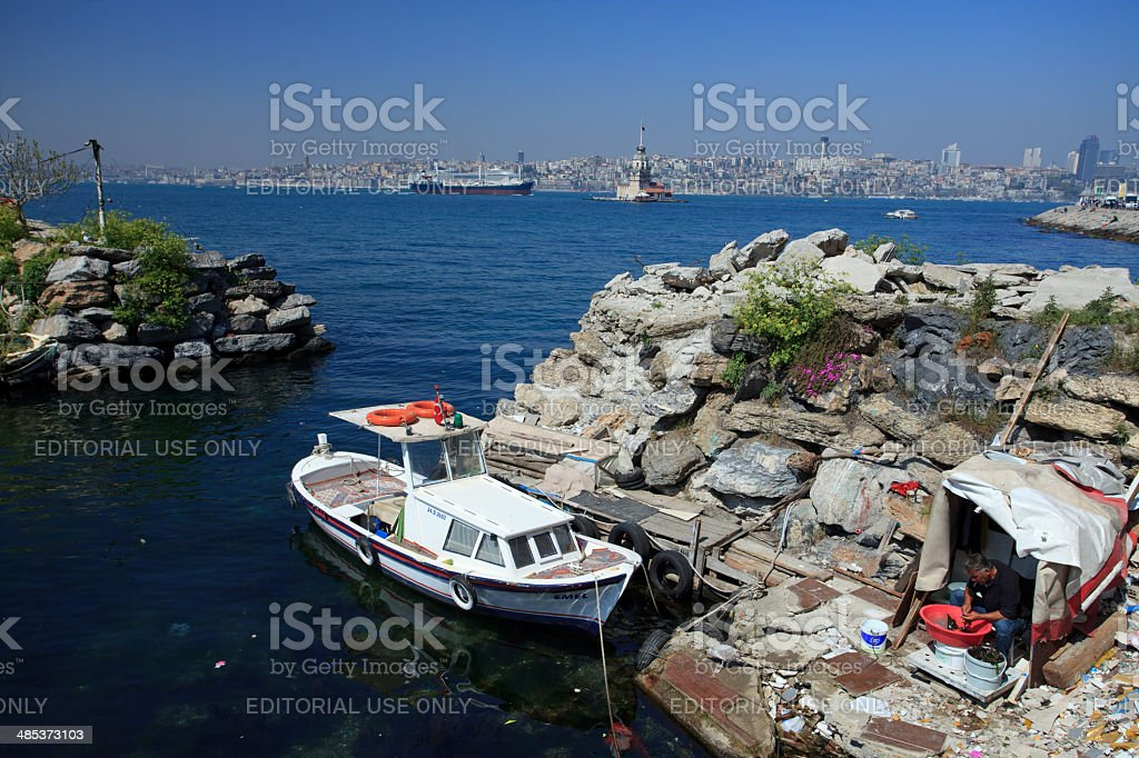 Fisherman cleaning seashells in Bosphorus strait royalty-free stock photo