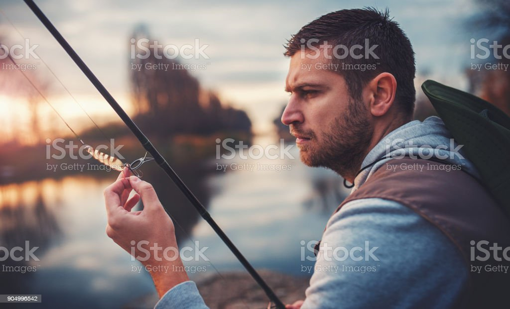 Fisherman enjoys in fishing on the river. Sport, recreation, lifestyle stock photo