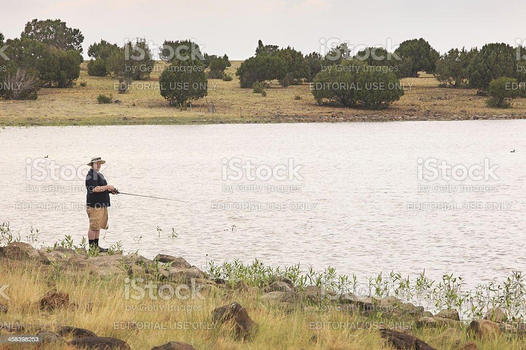 Fisherman Fishing Kinnikinick Lake Arizona royalty-free stock photo