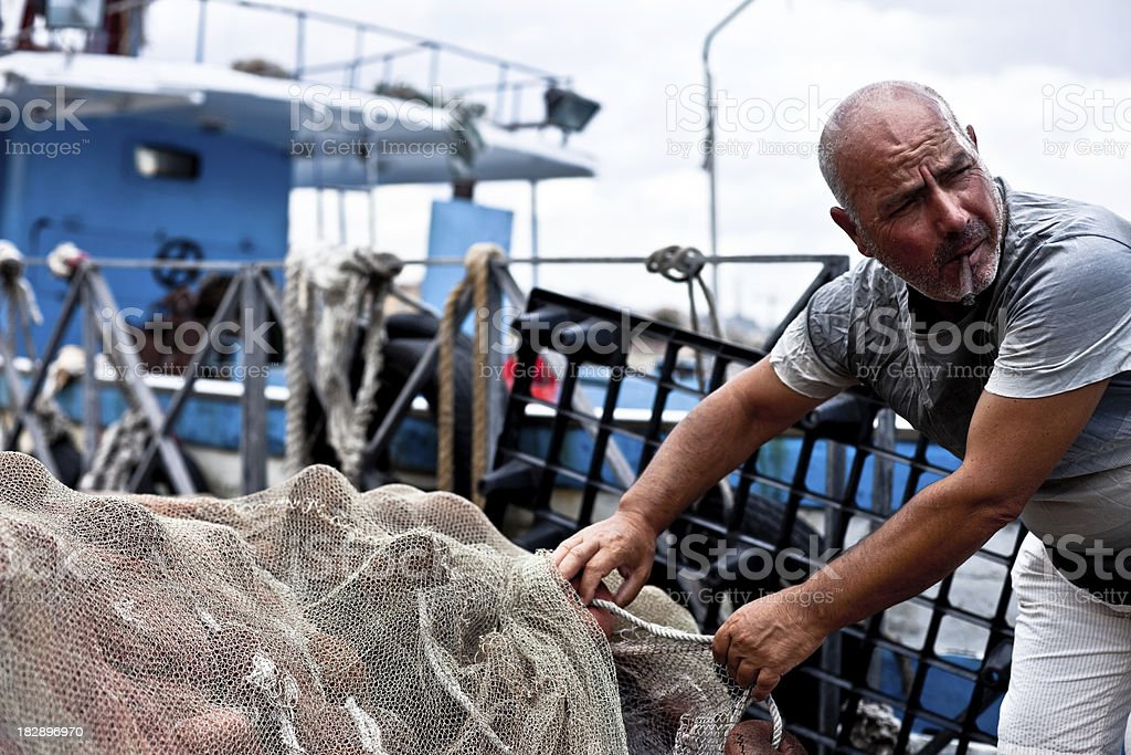 Fisherman Holding Fishing Net stock photo