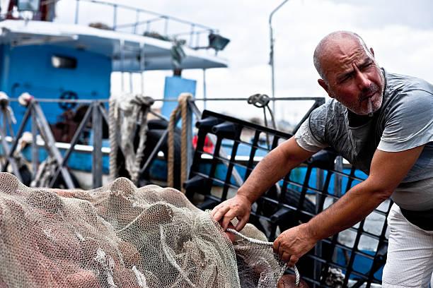 Fisherman Holding Fishing Net stock photo