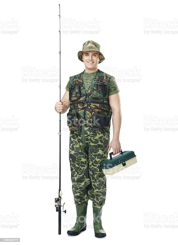 fisherman in camouflage holding a fishing equipment stock photo