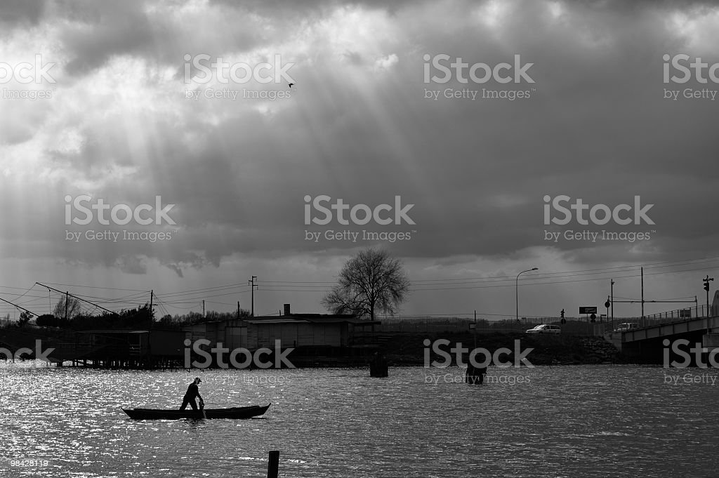 Fisherman in the Comacchio Valley royalty-free stock photo