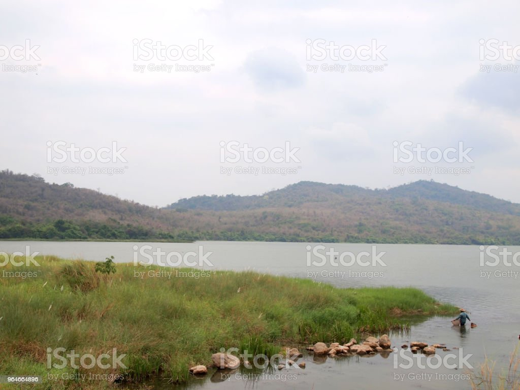 fisherman in the river at thailand royalty-free stock photo