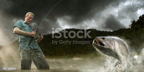 istock Fisherman Lands Dangerous Payara Fish in Amazon 180760634