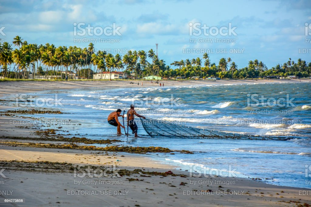 Fisherman on Acau Beach, Paraiba,Brazil stock photo