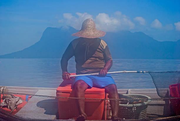 Fisherman on Bako River stock photo