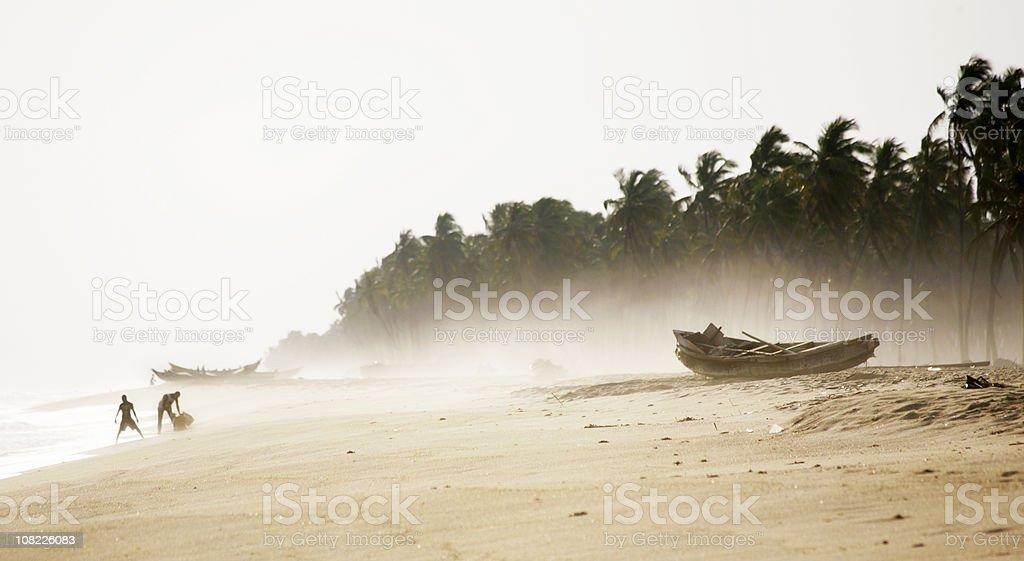Fisherman on Beach stock photo