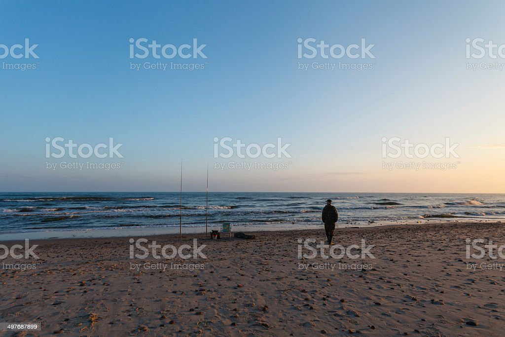 Fisherman on beach royalty-free stock photo