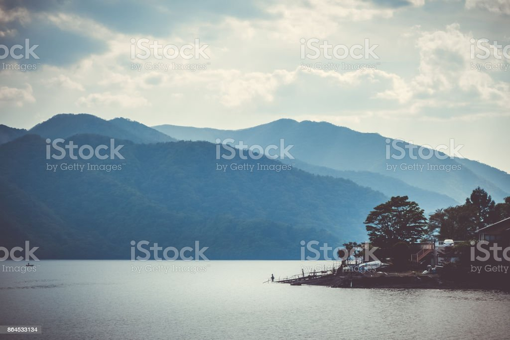 Fisherman on Chuzenji lake, Nikko, Japan stock photo
