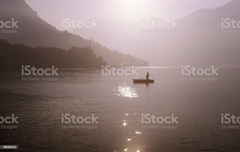 Fisherman on Lake Lugano, Switzerland royalty-free stock photo