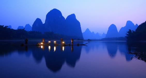 Fishermen fishing in the Evening,Li Jiang River,Yangshuo,Guilin,Guangxi,China.