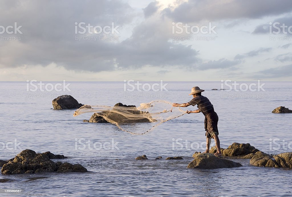 Fisherman on the beach in Ngwe Saung royalty-free stock photo