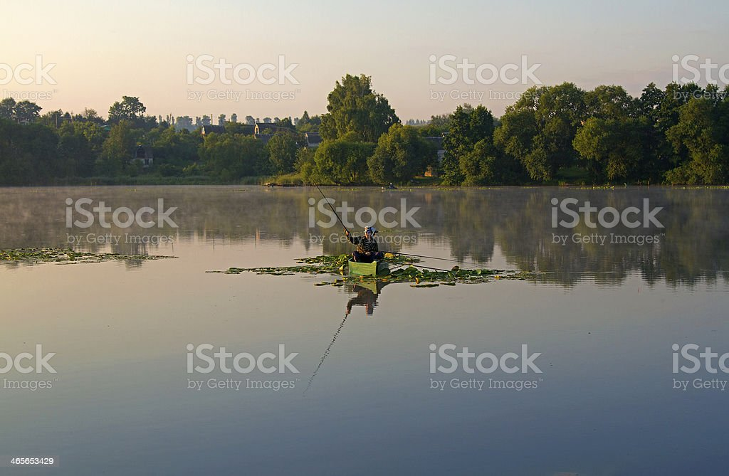 Fisherman on the boat royalty-free stock photo