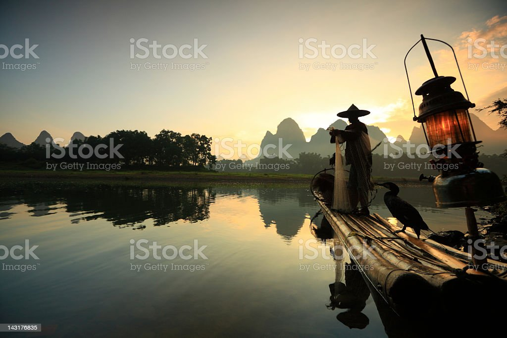 A fisherman on the li river at sunset stock photo