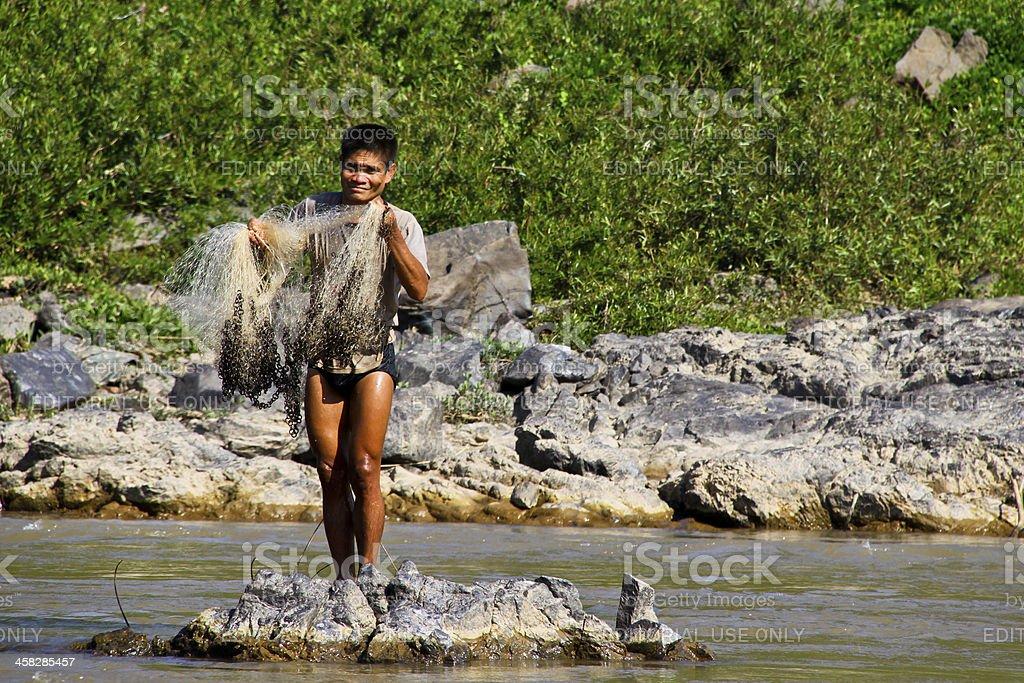 Fisherman on the Mekong river, Laos royalty-free stock photo
