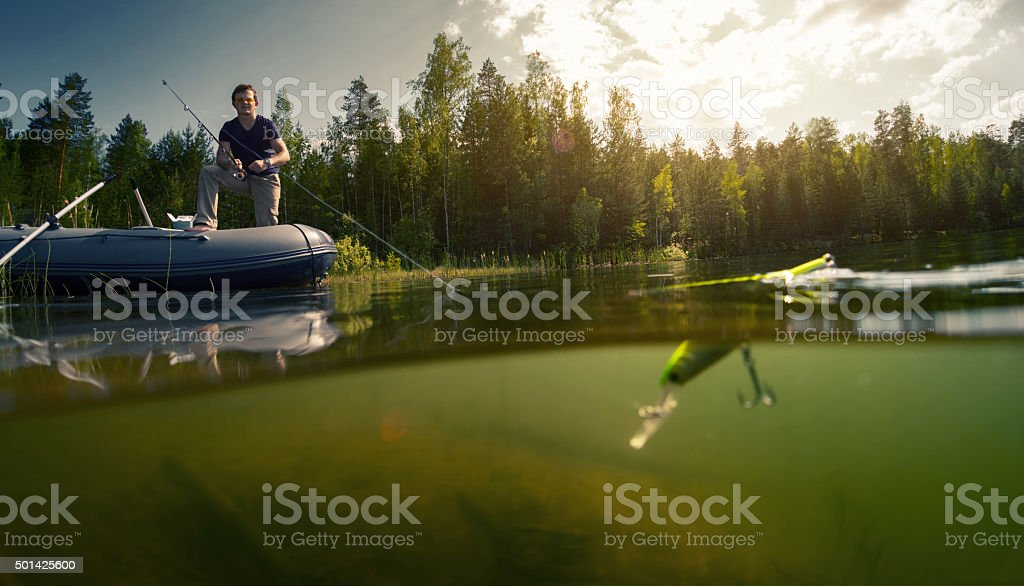 Fisherman on the pond stock photo