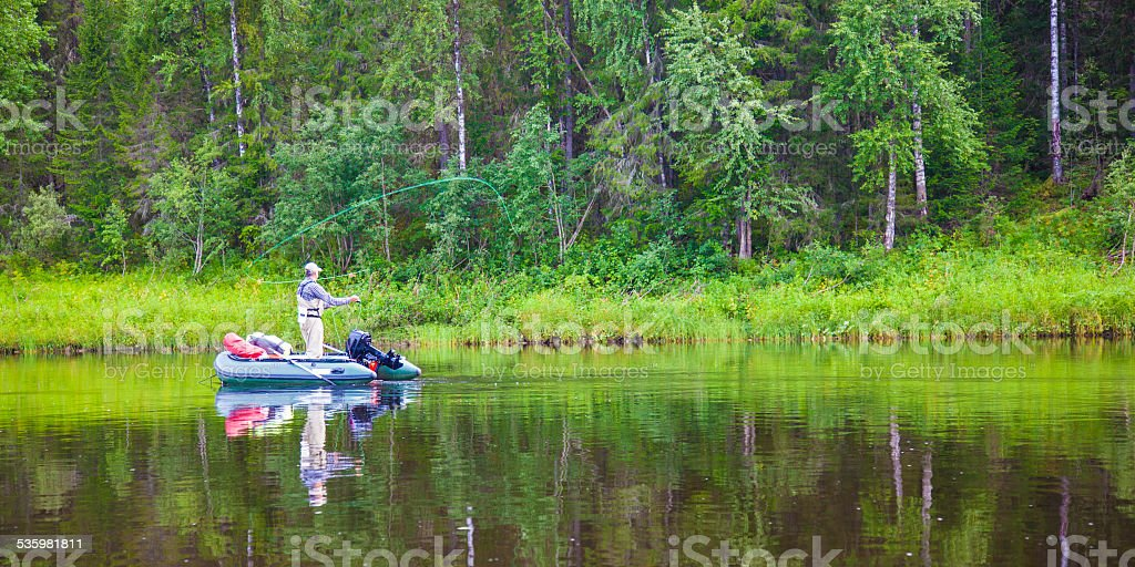 Fisherman on the river stock photo