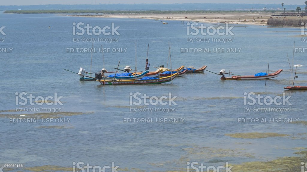 Fisherman on vessels moored near the Bay of Bengal stock photo