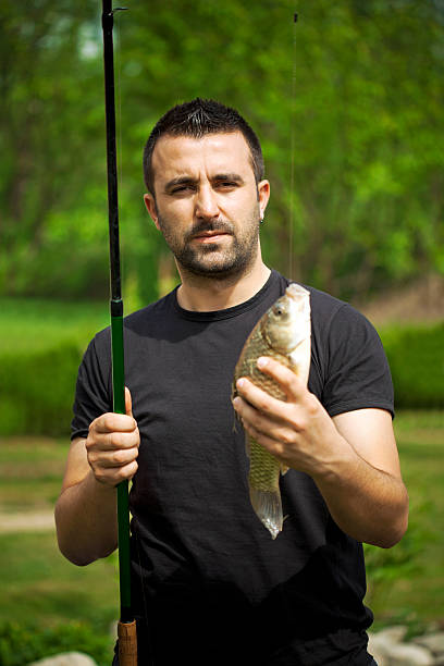fisherman - lepro stock pictures, royalty-free photos & images