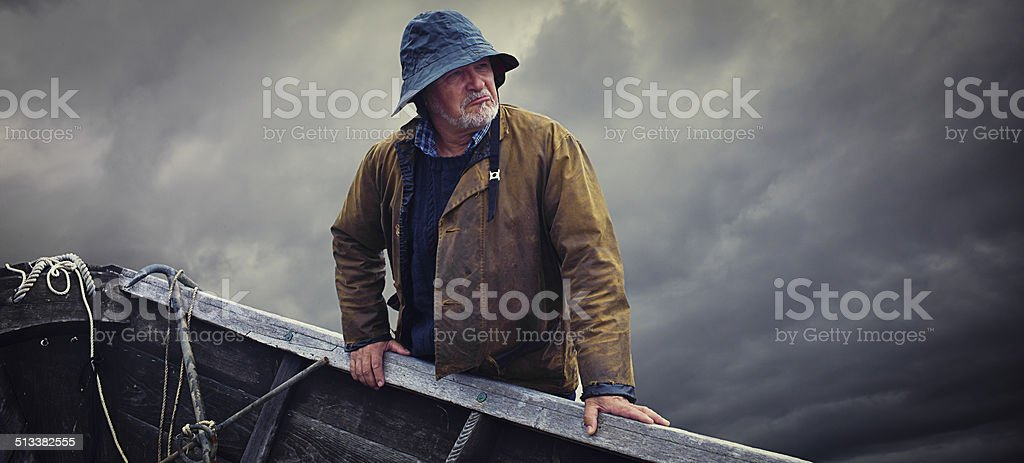 Fisherman Portrait, Stormy Sky and Dory, Nova Scotia stock photo