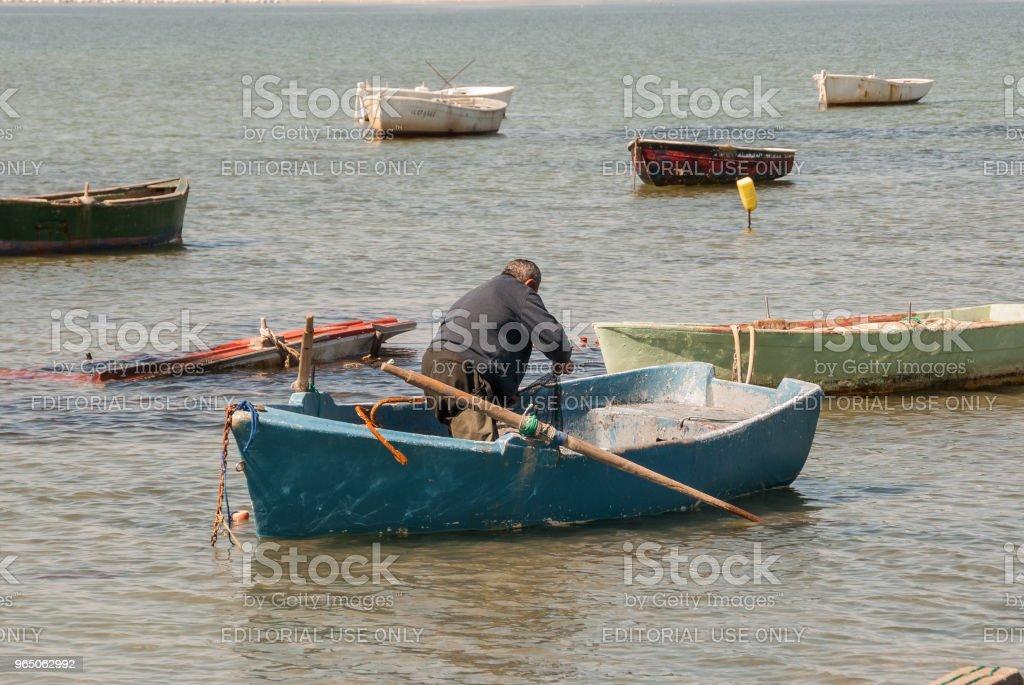 Fisherman prepares his boat in the Mar Menor in February 2011 zbiór zdjęć royalty-free