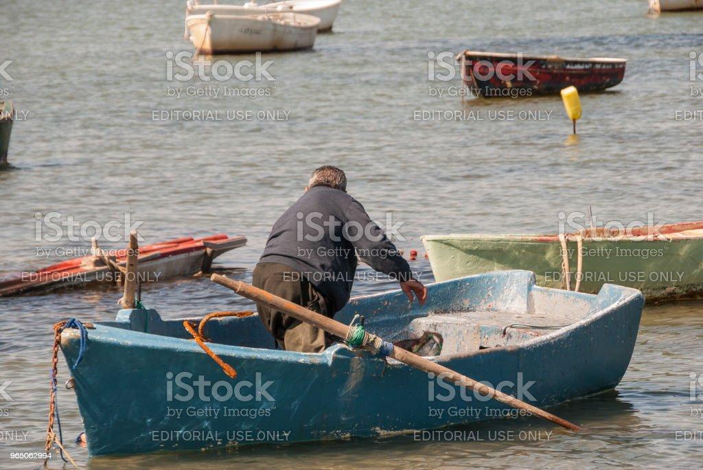 Fisherman prepares his boat in the Mar Menor in February 2011 royalty-free stock photo