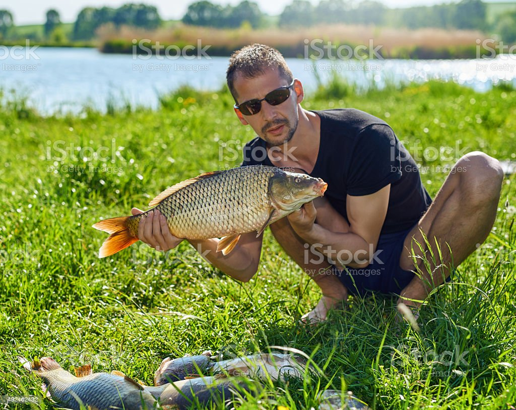 fisherman proud of his capture stock photo