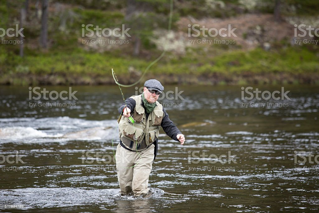 Fisherman put the fly line towards viewer stock photo