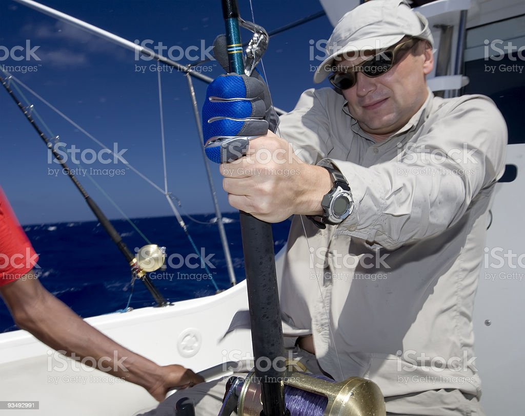 Fisherman sailing a boat on the ocean royalty-free stock photo