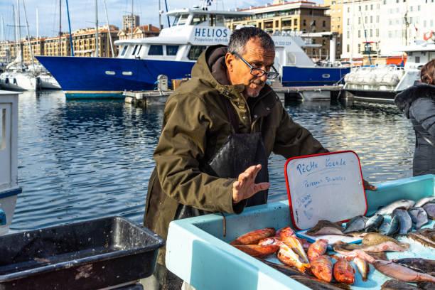 A fisherman selling fresh fish at Marseille fish market, France stock photo