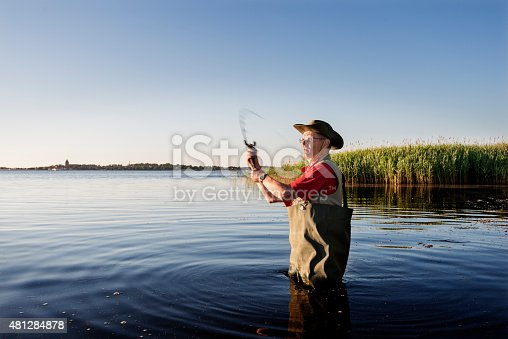 483319252istockphoto Fisherman Wearing Waders Casting His Line Out 481284878