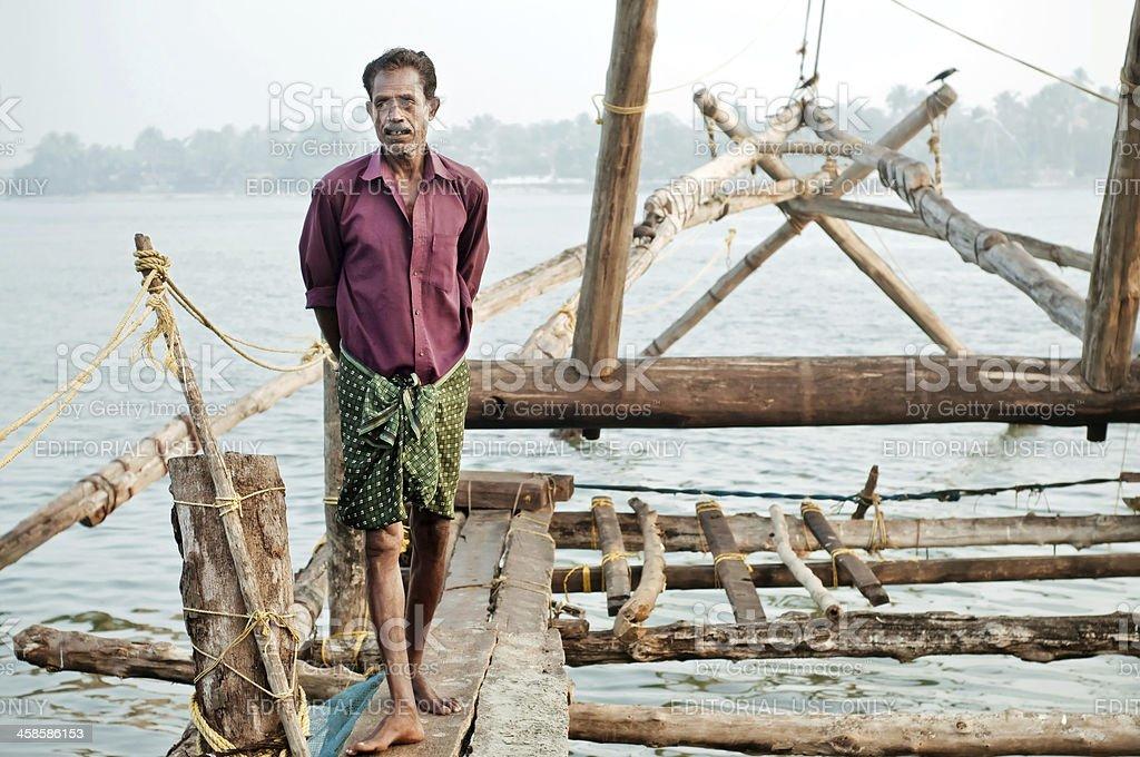 Fisherman with chinese fishing nets stock photo