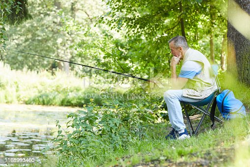 483319252 istock photo Fisherman with fishing rod outdoors 1168993460