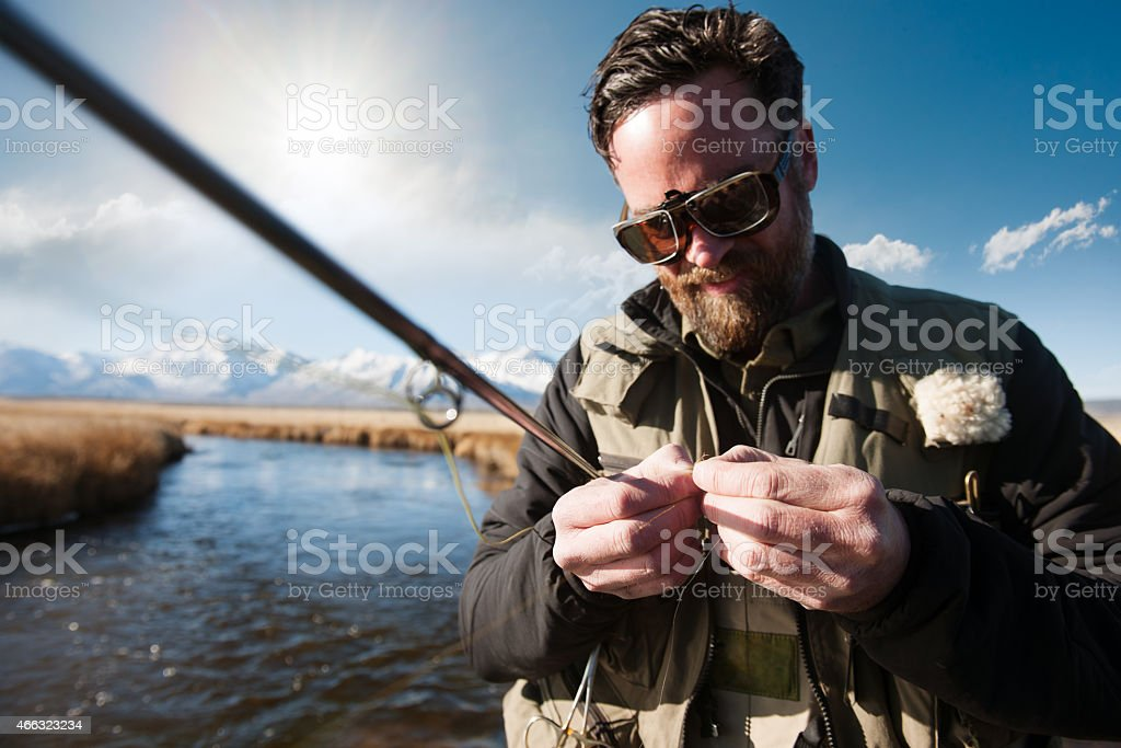Fisherman With Magnifying Glasses stock photo